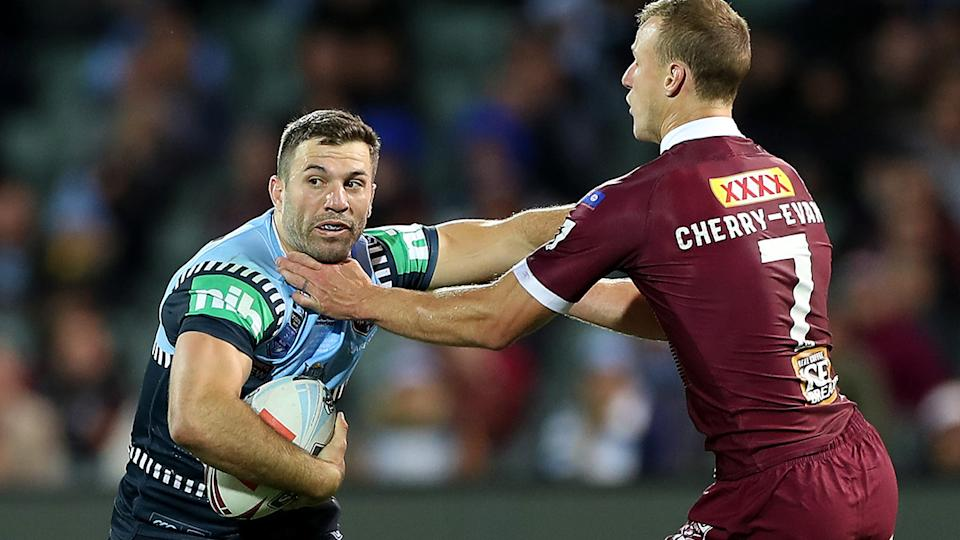 James Tedesco is pictured fending off Daly Cherry-Evans during the first game of the 2020 State of Origin series.