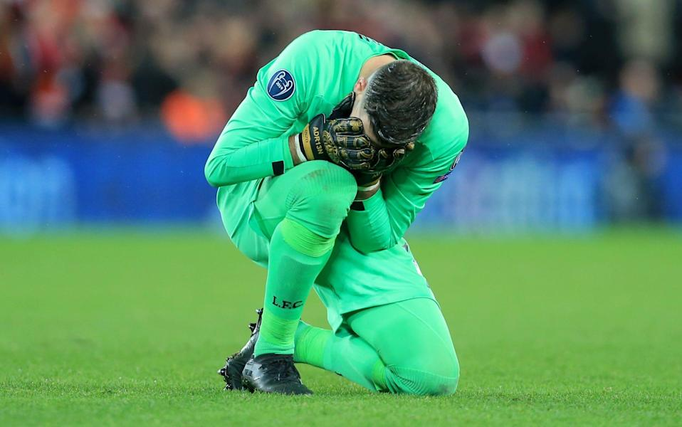 Adrian hides his head in his hands after gifting Atletico Madrid a goal - GETTY IMAGES