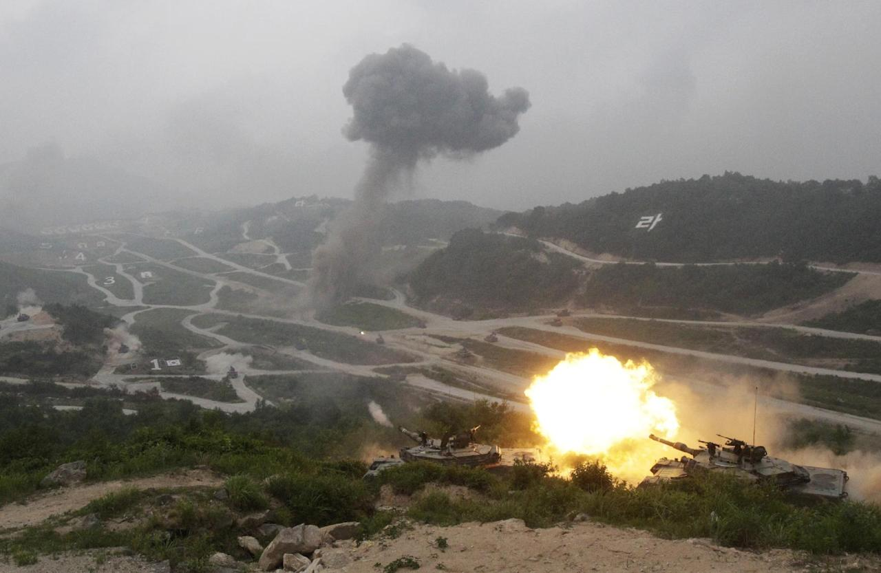 A South Korean Army K1A1 tank fires during a South Korea-U.S. joint military live-fire drill at Seungjin Fire Training range in Pocheon, South Korea, near the border with the North Korea, Friday, June 22, 2012. The drills were held in a show of combat readiness ahead of the 62nd anniversary of the start of the Korean War on June 25. (AP Photo/Ahn Young-joon)