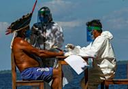 Getting vaccines to Amazon rainforest residents poses a special challenge for Brazilian healthworkers, who performed a rapid Covid test on Chief Domingos from the Arapuim tribe in July in Para state