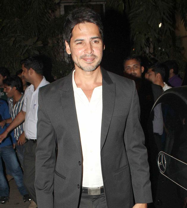 Dino Morea strikes a pose for the shutterbugs