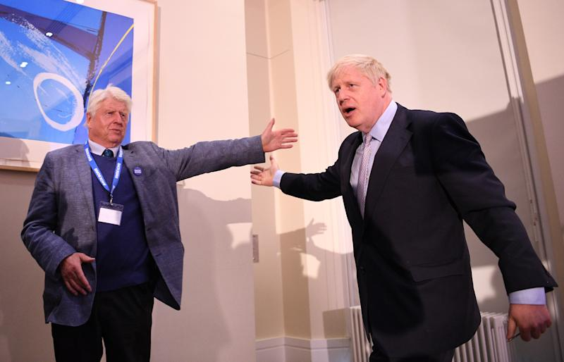 Boris Johnson is congratulated by his father, Stanley, after launching his Conservative Party leadership campaign (Photo by Leon Neal/Getty Images)