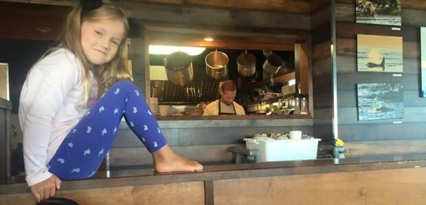 Chris Fawbert at work in his cafe kitchen with his daughter nearby. The Java Shack owner sent out an appeal for support to keep his small Campbell River cafe afloat because he feared new travel and tourism restrictions would force it to close permanently.