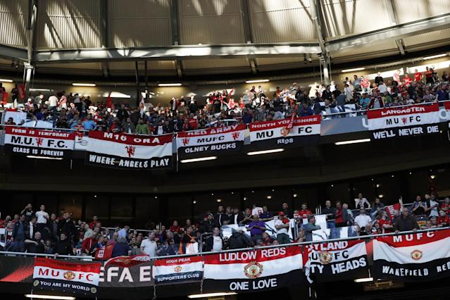 <p>Manchester United fans display banners before the match. Reuters / Lee Smith Livepic </p>