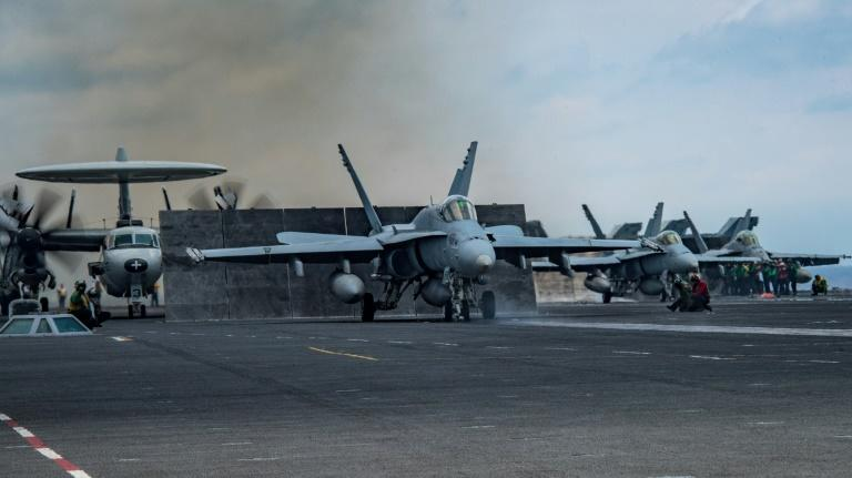 An F/A-18C Hornet prepares to launch from the USS Carl Vinson this month