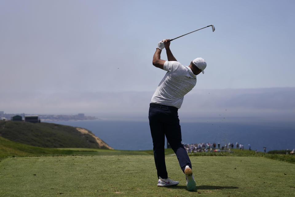 Brooks Koepka plays his shot from the third tee during the first round of the U.S. Open Golf Championship, Thursday, June 17, 2021, at Torrey Pines Golf Course in San Diego. (AP Photo/Jae C. Hong)