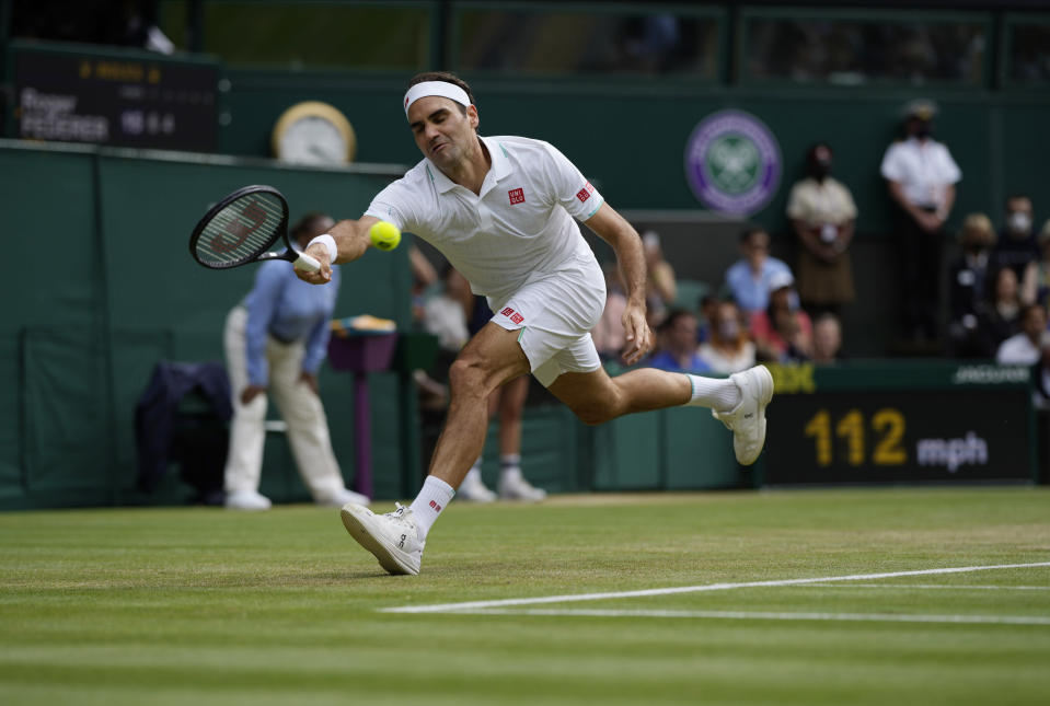 Switzerland's Roger Federer plays a return to Britain's Cameron Norrie during the men's singles third round match on day six of the Wimbledon Tennis Championships in London, Saturday July 3, 2021. (AP Photo/Alastair Grant)