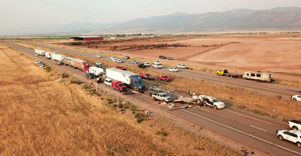 This photo provided by the Utah Highway Patrol and posted on the Utah Department of Public Safety website shows the scene of a fatal pileup, Sunday, July 25, 2021, on Interstate 15 in Millard County, near the town of Kanosh, Utah. (Utah Highway Patrol via AP)