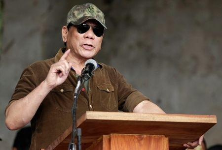 Philippine President Rodrigo Duterte gestures while delivering a speech during his visit at Bangolo town, Marawi city, southern Philippines October 17, 2017. REUTERS/Stringer  NO RESALES. NO ARCHIVE - RC1DF73BF6A0