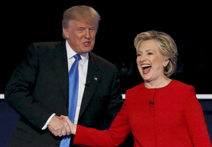 Donald Trump and Hillary Clinton shake hands at the conclusion of their third and final presidential debate.