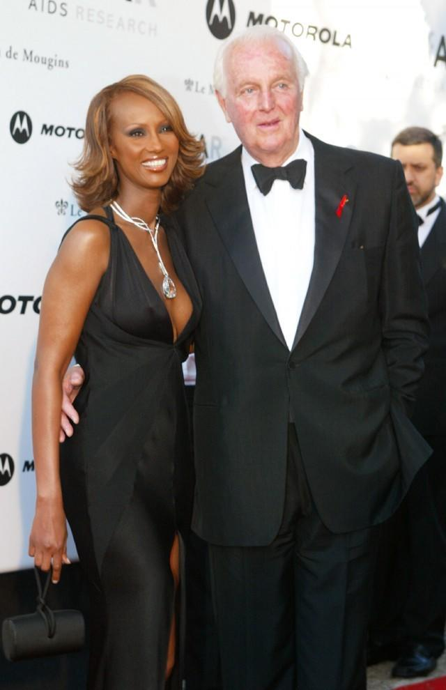<p>Supermodel Iman and Hubert de Givenchy attend an annual AIDS benefit during the 55th annual Cannes Film Festival on May 23, 2002 in Mougins, France.</p> <div> Getty Images </div>