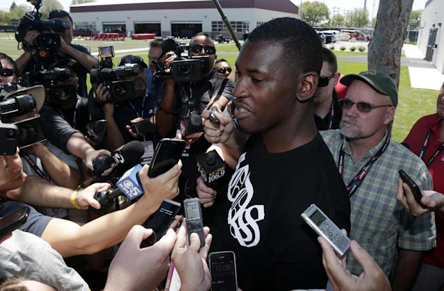 San Francisco 49ers' Aldon Smith talks to reporters during an NFL football training camp on Thursday, July 24, 2014, in Santa Clara, Calif. (AP Photo)