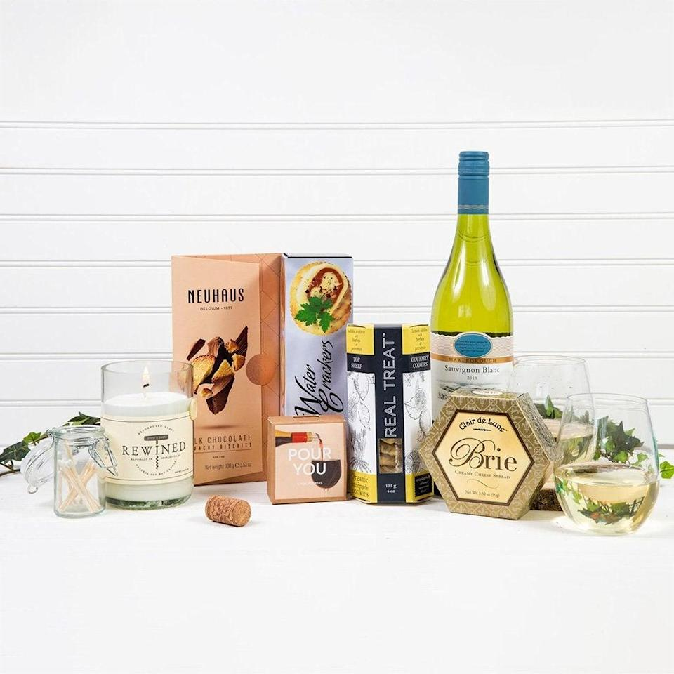 """<h2>Welcoming White Wine Gift Basket</h2><br>Make any occasion more delightful with this flavorful gift basket that pairs Sauvignon Blanc with tasty sweet and salty snack assortments.<br><br><strong><em><a href=""""https://giftbasket.com/collections/wine-gift-baskets"""" rel=""""nofollow noopener"""" target=""""_blank"""" data-ylk=""""slk:Shop Giftbasket.com"""" class=""""link rapid-noclick-resp"""">Shop Giftbasket.com</a></em></strong> <br><br><strong>Gift Basket</strong> Welcoming White Wine Gift Basket, $, available at <a href=""""https://go.skimresources.com/?id=30283X879131&url=https%3A%2F%2Fgiftbasket.com%2Fproducts%2Fwelcoming-wine-gift-basket"""" rel=""""nofollow noopener"""" target=""""_blank"""" data-ylk=""""slk:Gift Basket"""" class=""""link rapid-noclick-resp"""">Gift Basket</a>"""