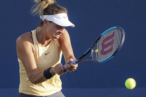 Madison Keys, of the United States, returns to Simona Halep, of Romania, during the quarterfinals of the Western & Southern Open tennis tournament, Thursday, Aug. 15, 2019, in Mason, Ohio. (AP Photo/John Minchillo)