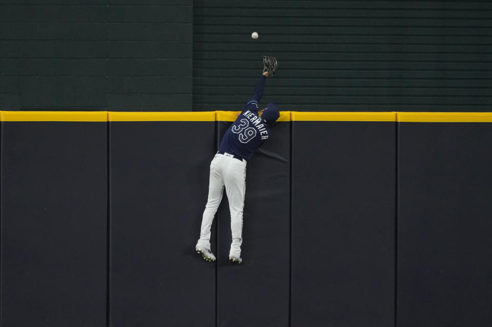Tampa Bay Rays center fielder Kevin Kiermaier can't get a glove on a home run by Los Angeles Dodgers' Justin Turner during the first inning in Game 4 of the baseball World Series Saturday, Oct. 24, 2020, in Arlington, Texas. (AP Photo/Tony Gutierrez)
