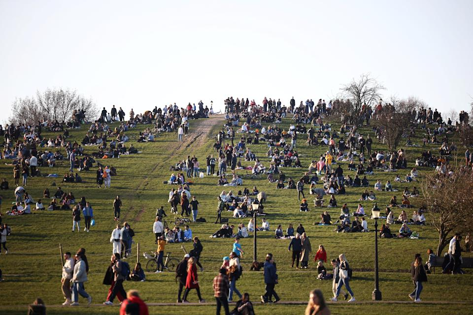 <p>People gather in their thousands in Primrose Hill</p> (Reuters)