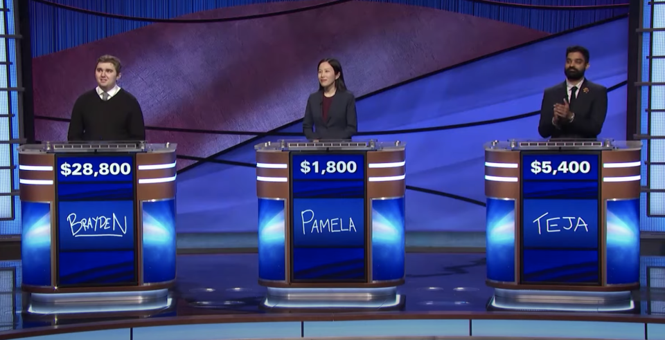 Brayden Smith (left) appears with two other contestants on Jeopardy!.