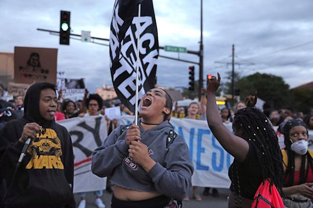 <p>Supporters of Philando Castile hold signs as they march along University Avenue in St. Paul, Minn., leaving a vigil at the state Capitol on Friday, June 16, 2017. St. Anthony police Officer Jeronimo Yanez was cleared of all charges in the fatal shooting last year of Castile. (Anthony Souffle/Star Tribune via AP) </p>