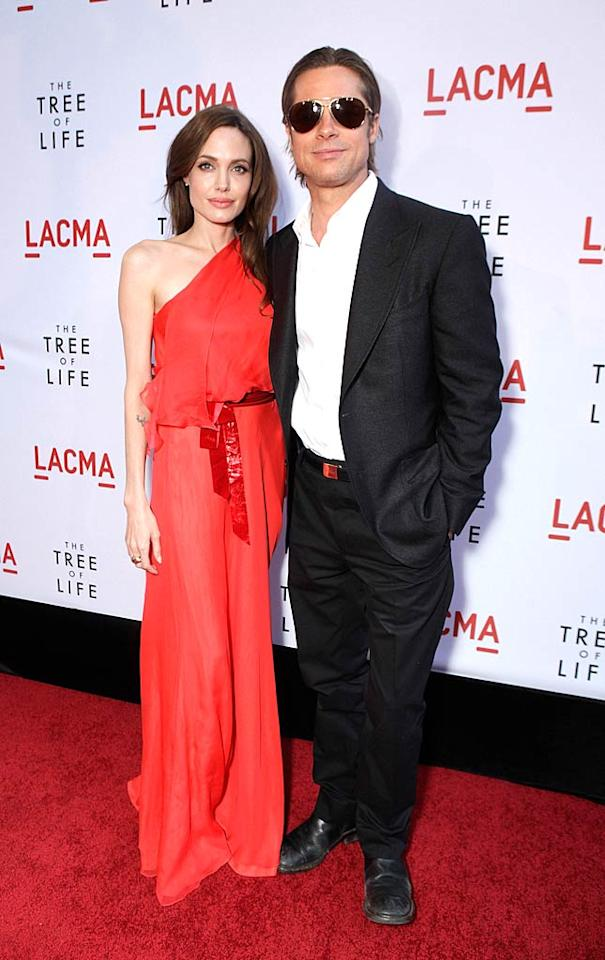 "Hollywood's hottest couple -- Angelina Jolie and Brad Pitt -- looked exceptional upon arriving at Tuesday night's premiere of ""The Tree of Life."" Brad -- who stars in the Terrence Malick-directed drama -- donned a casual Tom Ford tux and was freshly shaven following a scruffy week at the Cannes Film Festival. Accompanying him was his partner-in-crime, Angelina, who oozed glamour in a bright red, Grecian-inspired Jenny Packham gown and simple Tiffany & Co. jewels. Va-va-voom! Todd Williamson/<a href=""http://www.wireimage.com"" target=""new"">WireImage.com</a> - May 24, 2011"