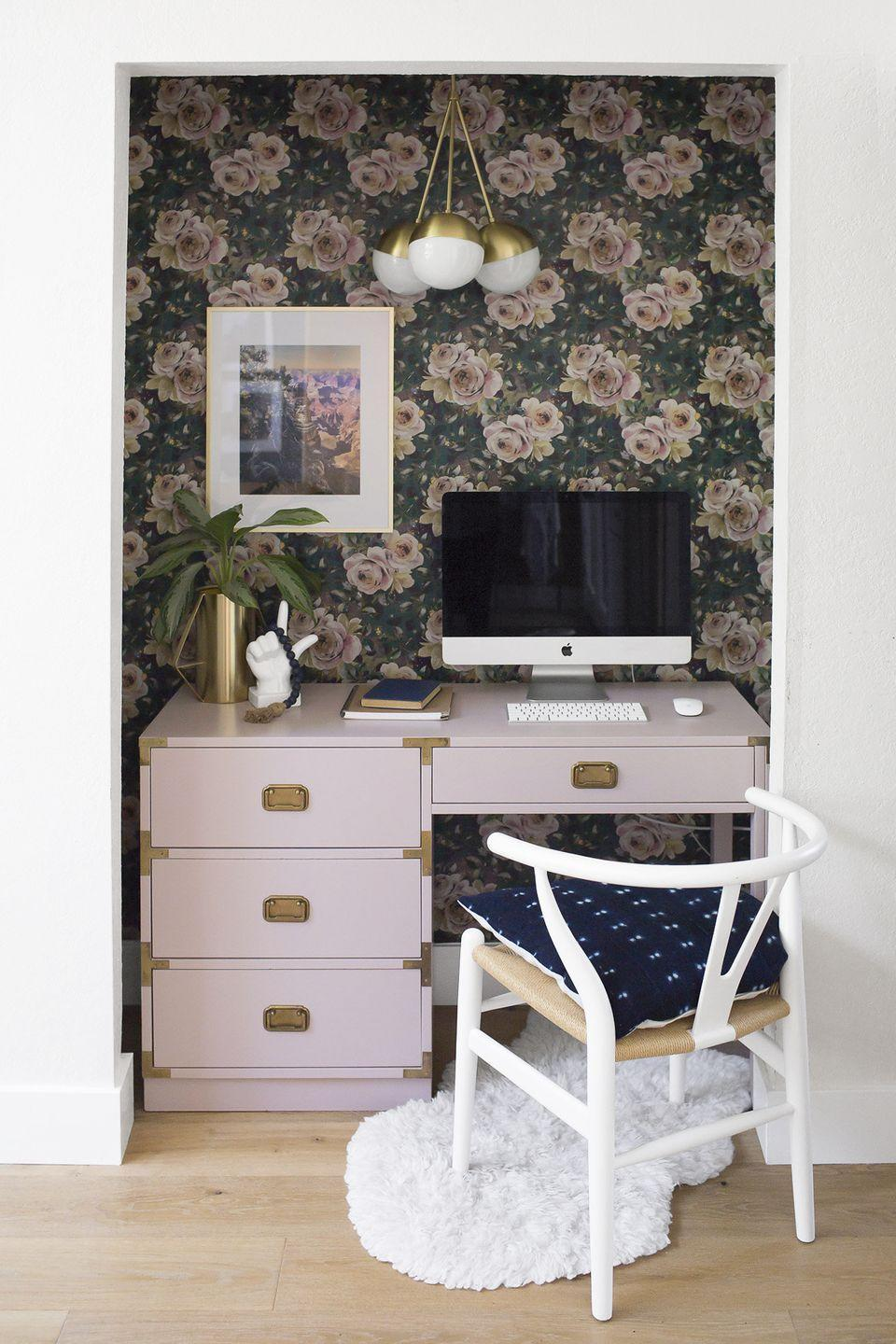 <p>No office in your floor plan? Make your own by removing the doors of an empty closet and turning it into a cozy office space. Decorate it like you would any other room: Add wallpaper, light fixtures, and decorative touches. </p>