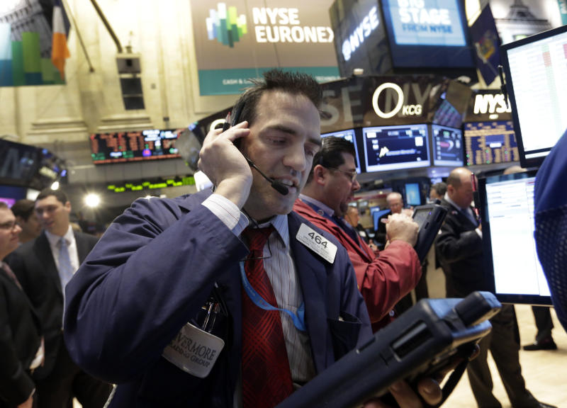 Trader Gregory Rowe works on the floor of the New York Stock Exchange Monday, Nov. 11, 2013. Investors this week will look for evidence that Americans are ready to start spending for the holidays. (AP Photo/Richard Drew)