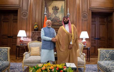 FILE PHOTO: Saudi Arabia's Crown Prince Mohammed bin Salman shakes hands with India's Prime Minister Narendra Modi in Buenos Aires