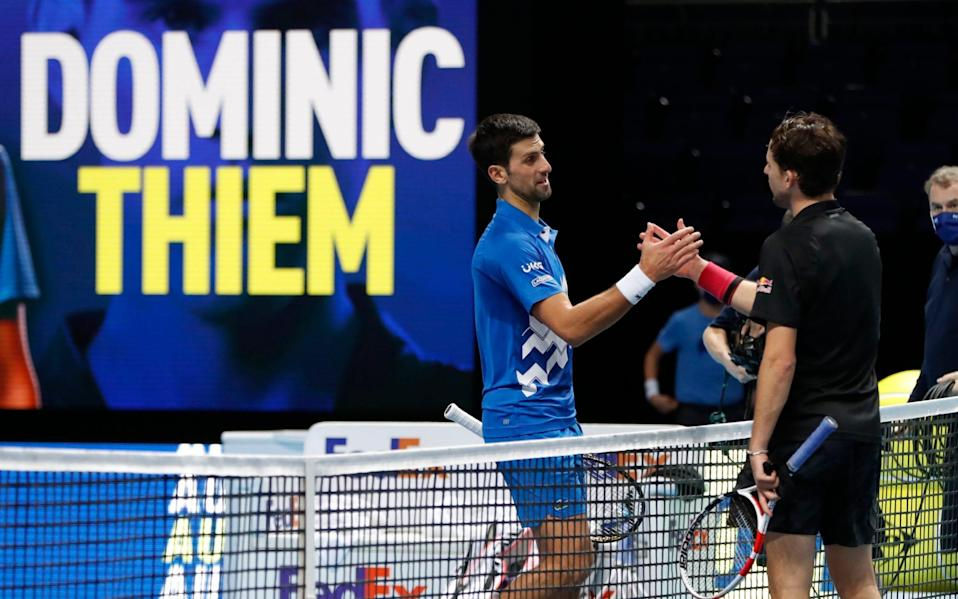 Djokovic and Thiem shake hands after the latter's victory in their semi-final - ACTION IMAGES