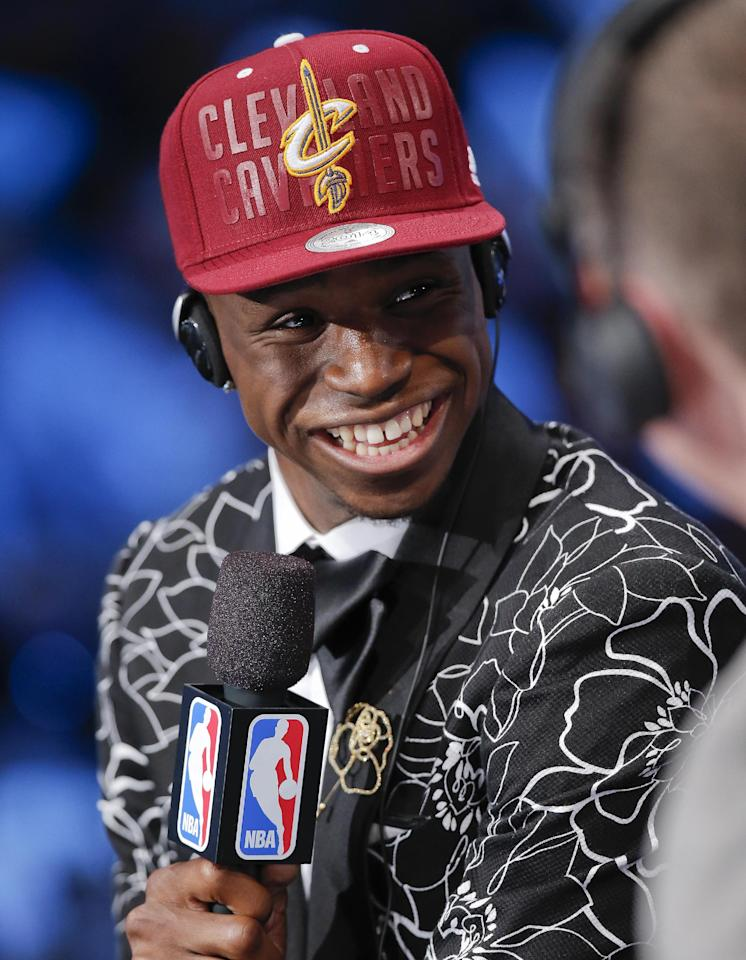 Kansas' Andrew Wiggins answers questions during an interview after being selected as the number one pick overall by the Cleveland Cavaliers during the 2014 NBA draft, Thursday, June 26, 2014, in New York. (AP Photo/Kathy Willens)