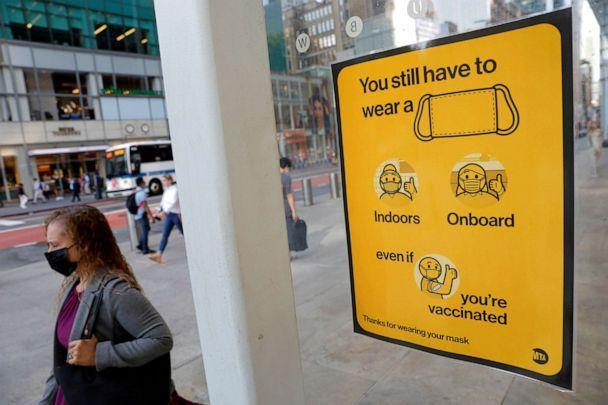 PHOTO: A poster alerting for the wearing of masks is seen on a 42nd Street subway entrance as cases of the infectious coronavirus Delta variant continue to rise in New York, Aug. 2, 2021. (Andrew Kelly/Reuters)