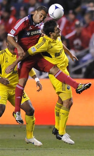 Chicago Fire's Shejill MacDonald left, goes up for a header against Columbus Crew's Milovan Mirosevic right, during the first half of an MLS soccer game in Bridgeview, Ill., Saturday, Sept. 22, 2012. (AP Photo/Paul Beaty)