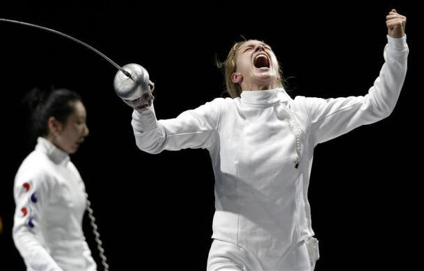 LAST SECOND LEADS TO TEARS: Germany's Britta Heidemann (R) celebrates defeating South Korea's Shin A Lam during their women's épée individual semifinal fencing competition at the ExCel venue at the London 2012 Olympic Games July 30, 2012.