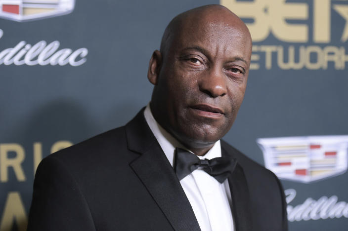 "FILE - In this Sunday, Feb. 25, 2018 file photo, John Singleton attends the 2018 American Black Film Festival Honors at the Beverly Hilton Hotel in Beverly Hills, Calif. In April, Hollywood lost director John Singleton, whose 1991 film ""Boyz N the Hood"" was praised as a realistic and compassionate take on race, class, peer pressure and family. He became the first black director to receive an Oscar nomination and the youngest at 24. (Photo by Richard Shotwell/Invision/AP, File"