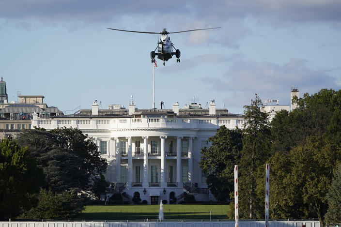 The helicopter that will carry President Donald Trump to Walter Reed National Military Medical Center in Bethesda, Md., lands on the South Lawn of White House in Washington, Friday, Oct. 2, 2020. The White House says Trump will spend a