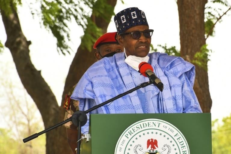 Federal vs. state: President Muhammadu Buhari's government is embroiled in a row over who has the right to collect VAT in Nigeria (AFP/Audu Marte)