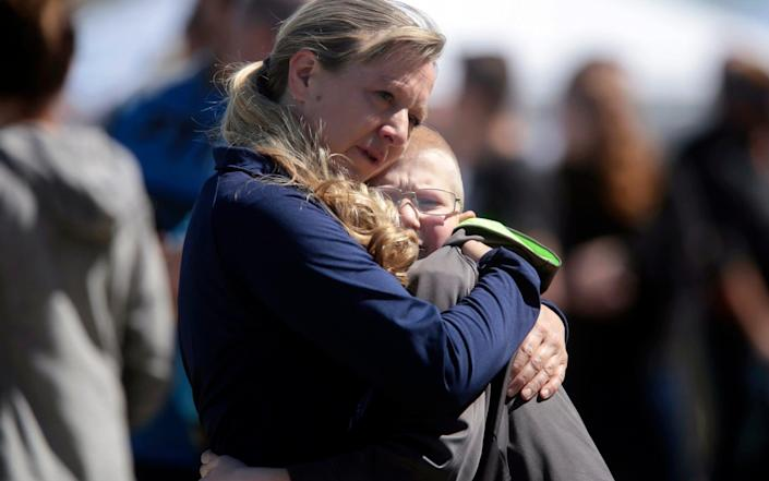 A mother and child embrace after a school shooting at Rigby Middle School in Rigby, Idaho - John Roark/The Idaho Post-Register