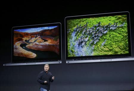 Philip W. Schiller, the Senior Vice President of worldwide marketing at Apple Inc speaks on stage during an Apple event in San Francisco