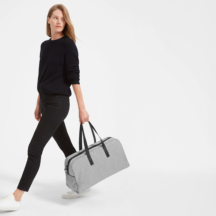 """<h3><strong>Everlane Twill Weekender</strong></h3><br>Made from durable twill with leather handles, this compact weekender is both soft and structured enough to safely store a few days worth of stuff.<br><br><em>Shop <strong><a href=""""https://www.everlane.com"""" rel=""""nofollow noopener"""" target=""""_blank"""" data-ylk=""""slk:Everlane"""" class=""""link rapid-noclick-resp"""">Everlane</a></strong></em><br><br><strong>Everlane</strong> The Twill Weekender, $, available at <a href=""""https://go.skimresources.com/?id=30283X879131&url=https%3A%2F%2Fwww.everlane.com%2Fproducts%2Fwomens-twill-weekender-darkgreen"""" rel=""""nofollow noopener"""" target=""""_blank"""" data-ylk=""""slk:Everlane"""" class=""""link rapid-noclick-resp"""">Everlane</a>"""
