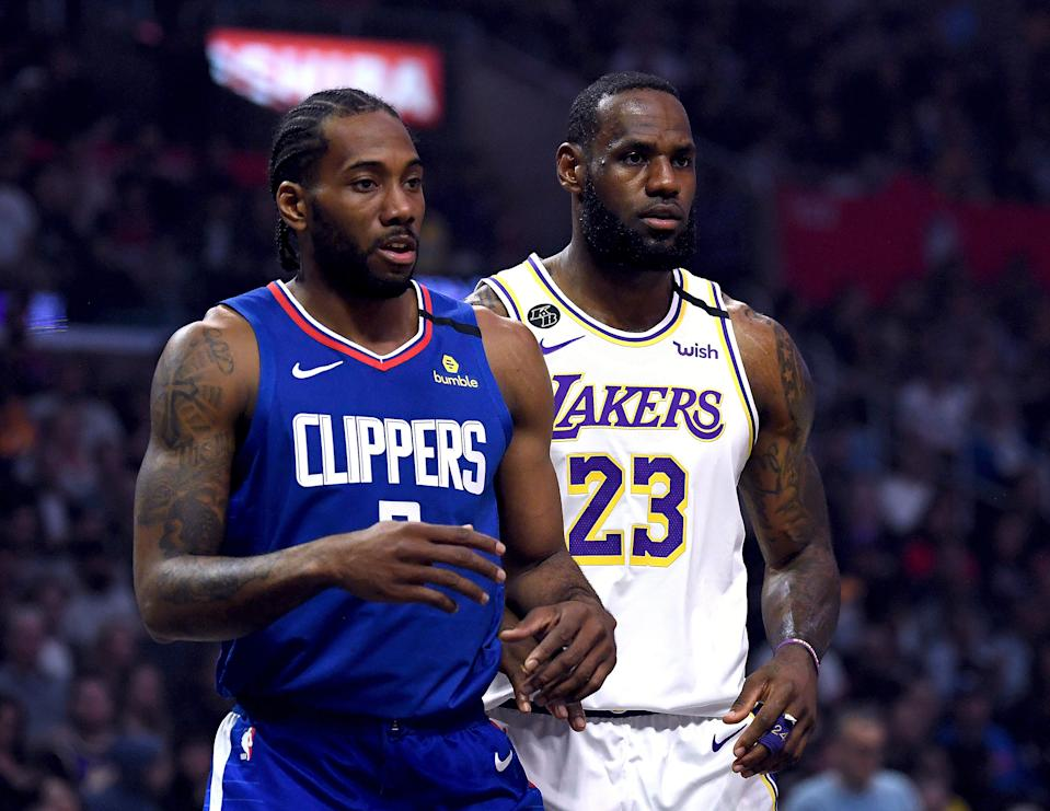Kawhi Leonard and LeBron James are familiar playoff foes, just not for the Los Angeles Clippers and Lakers. (Harry How/Getty Images)