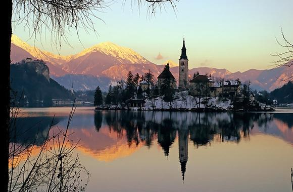 "<div class=""caption-credit""> Photo by: Smarter Travel</div><div class=""caption-title"">Lake Bled, Slovenia</div>Be transported to a medieval world during your trip to the Slovenia waterfront. <br> <i>Find out more at <a rel=""nofollow"" target=""_blank"" href=""https://ec.yimg.com/ec?url=http%3a%2f%2fwww.smartertravel.com%2fphoto-galleries%2feditorial%2fstunning-places-to-see-sunsets-around-the-world.html%3fid%3d169%26amp%3bphoto%3d25040%26quot%3b%26gt%3bSmarter&t=1513618266&sig=nZXIdIez26EnCOfv4MN6jA--~D Travel.</a></i> <br> <i><b>MORE ON BABBLE</b> <br> <a rel=""nofollow"" target="""" href=""http://www.babble.com/family-style/2012/08/30/10-quirkiest-hotels-in-the-world/?cmp=ELP%7Cbbl%7Clp%7CYahooShine%7CMain%7C%7C041913%7C%7C25PlacestoSeetheMostBeautifulSunset%7CfamE%7C%7C%7C"">The 10 strangest hotels you'll ever stay at</a> <br> <a rel=""nofollow"" target="""" href=""http://www.babble.com/family-style/2012/02/01/25-amazingly-tiny-houses/?cmp=ELP%7Cbbl%7Clp%7CYahooShine%7CMain%7C%7C041913%7C%7C25PlacestoSeetheMostBeautifulSunset%7CfamE%7C%7C%7C"">25 insanely tiny houses</a></i><i><br></i> <br> <i><a rel=""nofollow"" target=""_blank"" href=""http://www.smartertravel.com/photo-galleries/editorial/stunning-places-to-see-sunsets-around-the-world.html?id=169&photo=25040""></a></i>"