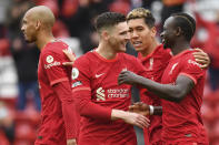 Liverpool's Sadio Mane, right, celebrates scoring his sides second goal during the English Premier League soccer match between Liverpool and Crystal Palace at Anfield stadium in Liverpool, England, Sunday, May 23, 2021. (Paul Ellis/Pool via AP)