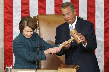 U.S. House Speaker John Boehner (R-OH) (R) takes the gavel from House Minority Leader Nancy Pelosi (D-CA) after being re-elected speaker on the House floor at the U.S. Capitol in Washington January 6, 2015.  REUTERS/Jonathan Ernst