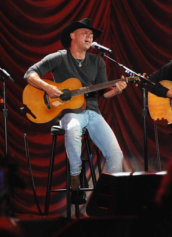 """LOS ANGELES, CA - OCTOBER 15:  (CALL FOR IMAGE, NO ARCHIVE, FOR EDITORIAL USE OF STORIES RELATED TO A DECADE OF DIFFERENCE: A CONCERT CELEBRATING 10 YEARS OF THE WILLIAM J. CLINTON FOUNDATION ONLY)  In this handout image provided by Getty Images, musician Kenny Chesney performs at """"A Decade of Difference:  A Concert Celebrating 10 Years of the William J. Clinton Foundation."""" The star-studded affair, a charitable event organized to raise awareness around Clinton Foundation's efforts to improve global health, strengthen economies worldwide, promote healthier childhoods, and protect the environment, was held at the iconic Hollywood Bowl on October 15, 2011 in Los Angeles, California.  (Photo by Kevin Mazur/Getty Images for Control Room)"""