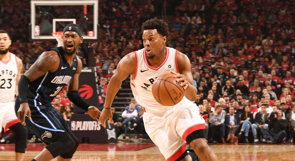 TORONTO, CANADA - APRIL 16: Kyle Lowry #7 of the Toronto Raptors drives to the basket against the Orlando Magic. (Photo by Ron Turenne/NBAE via Getty Images)