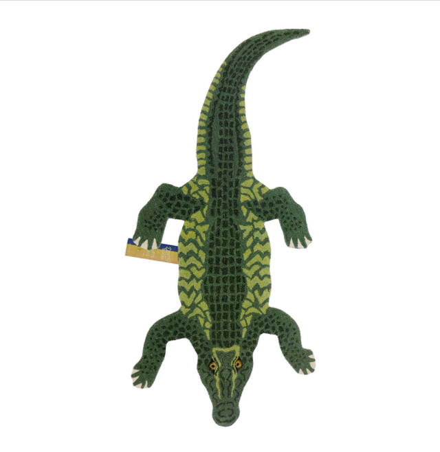 """For those who don't want to be muted at all, there's this enormous crocodile.<br><br><strong>Doing Goods</strong> Coolio Crocodile Rug - Green - Large, $, available at <a href=""""https://www.amara.com/products/coolio-crocodile-rug-green-large"""" rel=""""nofollow noopener"""" target=""""_blank"""" data-ylk=""""slk:Amara"""" class=""""link rapid-noclick-resp"""">Amara</a>"""