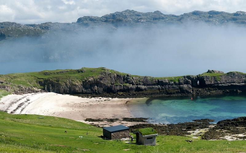 Beach and sea fog near the southern tip of Handa Island with the mainland beyond - www.alamy.com