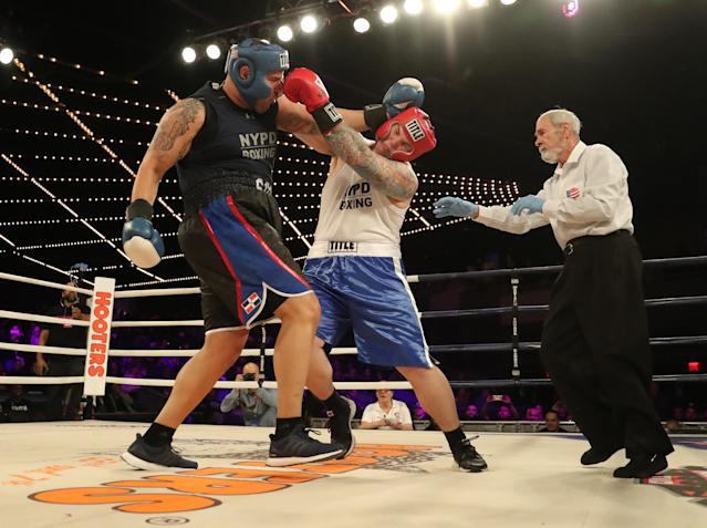 <p>Robert Marzano (red) and Jafet Sori (blue) mix it up in the TD1 ATU Grudge Match at the NYPD Boxing Championships at the Hulu Theater at Madison Square Garden on March 15, 2018. (Gordon Donovan/Yahoo News) </p>