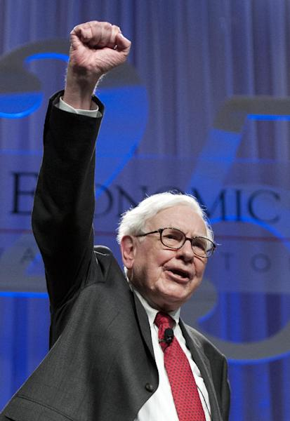Warren Buffett, chairman and CEO, Berkshire Hathaway, Inc., raises his fist and cheers as he is presented with a Woodrow Wilson High School letterman's jacket at the conclusion of the Economic Club of Washington's 25th anniversary celebration dinner in Washington, Tuesday, June 5, 2012. Buffett graduated from Woodrow Wilson High School in Washington in 1947. (AP Photo/Cliff Owen)