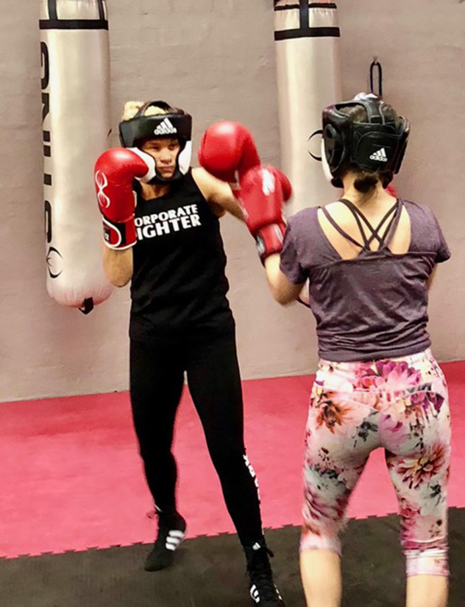A photo of Sydney woman Maria boxing with another woman in a gym