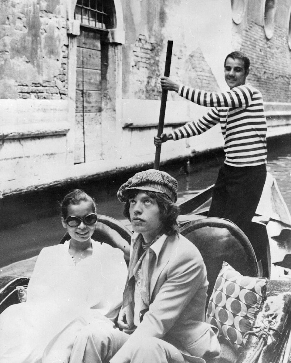 <p>Mick Jagger enjoys a relaxing gondola ride with his wife Bianca, on the Grand Canal in Venice after their wild wedding in St. Tropez in 1971.</p>