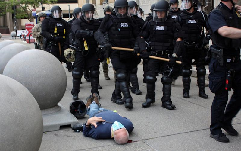 Martin Gugino lays on the ground after he was shoved by two Buffalo, New York, police officers - Jamie Quinn/Handout via REUTERS